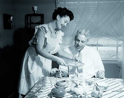 woman-serving-dinner-to-man-