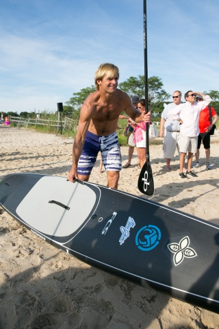 Laird-Hamilton-with-board-paddle-_144424457313.jpg_carousel_parties